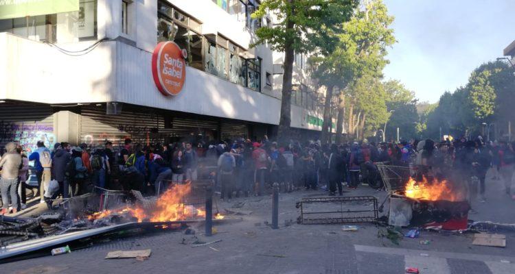 Detienen a joven por robo de caja fuerte durante saqueo a supermercado en centro de Concepción